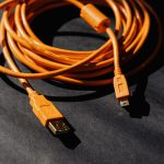 orange-usb-charger-cable-on-black-surface-4219862-150x150